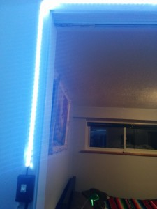 The light strip is run along the top and sides of the closet door.