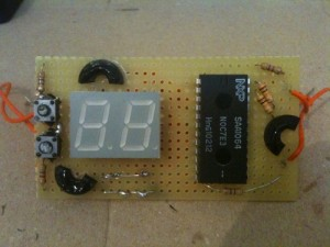 The front of the board - the half rubber washers are used to glue the perforated board to the inside of the enclosure